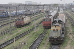 Romania passanger trains. Bucharest, Romania, March 13, 2016: Passenger trains are seen the switch yard of Gara de Nord main railway station Stock Image