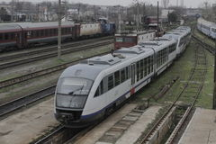 Romania passanger trains. Bucharest, Romania, March 13, 2016: Passenger trains are seen the switch yard of Gara de Nord main railway station Stock Images