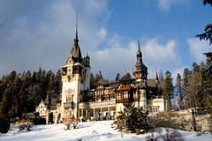 Romania Peles Castle. Old Romanian Peles castle near the mountain town of Sinaia. Winter landscape royalty free stock image