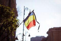 Romania`s flag at half mast. During a national day of mourning Royalty Free Stock Photo