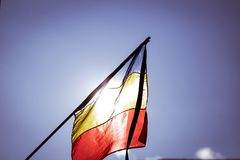 Romania`s flag at half mast. During a national day of mourning Stock Image