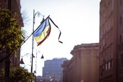 Romania`s flag at half mast. During a national day of mourning Royalty Free Stock Images