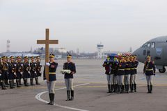 ROMANIA` S FORMER KING MICHAEL I DIES AT AGE OF 96. Romania` s former King Michael I body is carried by soldiers at Otopeni Airport, in Otopeni City, Wednesday Stock Images
