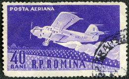 ROMANIA - 1960: shows Amphibian ambulance plane. ROMANIA - CIRCA 1960: A stamp printed in Romania shows Amphibian ambulance plane, series 50th anniv. of the Stock Photos