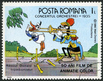 ROMANIA - 1986: shows Donald and trombonist, Walt Disney characters in the Band Concert, 1935, fifty years of Color Animated Films. ROMANIA - CIRCA 1986: A stamp royalty free illustration