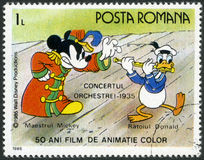 ROMANIA - 1986: shows Mickey and Donald,Walt Disney characters in the Band Concert, 1935, fifty years of Color Animated Films. ROMANIA - CIRCA 1986: A stamp royalty free illustration
