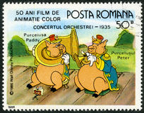 ROMANIA-1986: shows Paddy and Peter, Walt Disney characters in the Band Concert, 1935, devoted fifty years of Color Animated Films Royalty Free Stock Photography