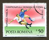 Romania stamp- CIRCA 1990: A stamp printed in Romania shows 1990 the world football championship in italy. stock photography