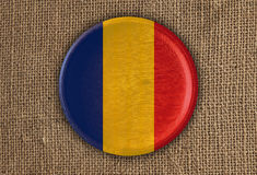 Romania Textured Round Flag wood on rough cloth. High Resolution Royalty Free Stock Photography