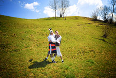 Romania traditional people. Two young traditional people in specific handmade clothes from Romania Stock Photo