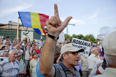 Romania unrest. Supporters of Romania's President Traian Basescu shout during a rally in Bucharest, protesting against the motion created by romanian lawmakers Stock Image
