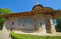 ROMANIA, VORONET - SEPTEMBER 28: Voronet Monastery in Romania on September 28, 2015 in Voronet, Romania. ROMANIA, VORONET - SEPTEMBER 28: Voronet old  Monastery Royalty Free Stock Images