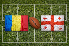 Romania vs. Georgia flags on rugby field Stock Photography