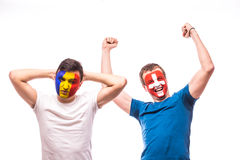 Romania vs  Switzerland. Football fans of national teams demonstrate emotions: Romania lose, Switzerland win. Stock Photo