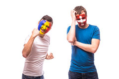 Romania vs  Switzerland. Football fans of national teams demonstrate emotions: Romania win, Switzerland lose. Stock Photos