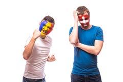 Romania vs  Switzerland. Football fans of national teams demonstrate emotions: Romania win, Switzerland lose. Stock Photos