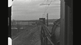 Train Traveling Through Rural Winter Landscape. ROMANIA, WINTER 1941. Three POV Shot Sequence From A Traveling Locomotive Train Through Rural Winter Landscape stock footage