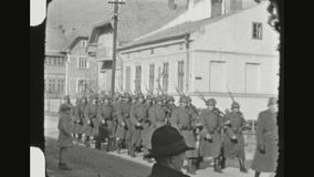 Romanian Infantry Marching. ROMANIA, WINTER 1942. Two Shot Sequence Of Romanian Axis Allies Infantry Division Marching In An Undisclosed Small Town stock footage
