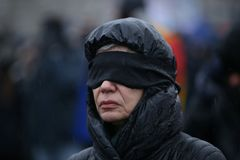 SILENT PROTEST IN BUCHAREST. Romanian actress Oana Pellea takes part at a silent protest against the changes to justice laws in Victoria Square, in front of the Royalty Free Stock Photography