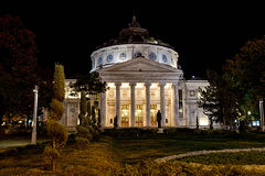 Romanian Athenaeum. Is a concert hall in Bucharest, on Calea Victoriei located in George Enescu Square (Revolution Square in the northern part). The building Royalty Free Stock Photo