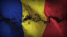 Romania grunge dirty flag waving on wind. Romanian background fullscreen grease flag blowing on wind. Realistic filth fabric texture on windy day Royalty Free Stock Image