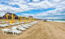 Romanian beach in a windy day, terrace with umbrellas Stock Photography