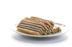 Romanian Cake with layers filled with cream made from walnuts. On a white background Stock Photos