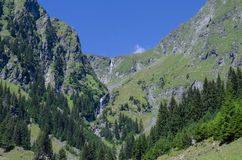 Romanian Carpathians. High mountains, wild nature, waterfall and blue sky Royalty Free Stock Image