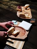 Romanian Cheese Nasal Cut On Wood Piece Stock Image