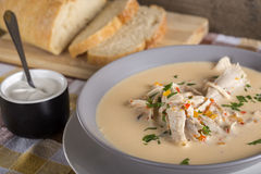 Romanian chicken soup named Ciorba Radauteana. On plate Stock Image
