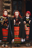 Romanian children in folklore costume. Romanian children in folklore traditional romanian costume singing Christmas carols at a local fair royalty free stock photos