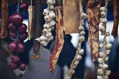 Romanian classic meat. Meathanging outdoor: bacon, garlic and onions royalty free stock photo