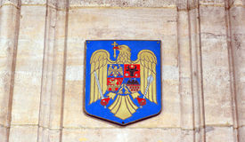 Romanian coat of arms on sandstone wall Royalty Free Stock Photo