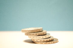 Romanian change. Romanian coins on a white and blue background stock images