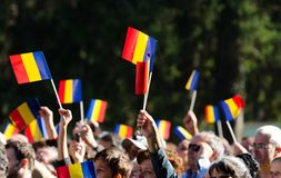 Romanian crowd waving flags. The public is greeting the Romanian Royal Family at Elisabeta Palace in Bucharest, Romania, during the Open Doors Event organised by