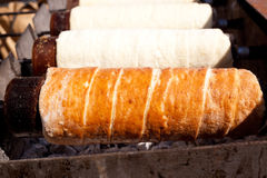 Romanian curly cake in chimney Stock Photos