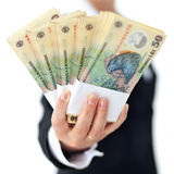 Romanian currency in woman hand - closeup, shallow depth Royalty Free Stock Images