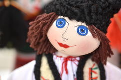 Romanian doll. Original handmade male doll with big blue eyes wearing traditional Romanian style clothes Stock Photo
