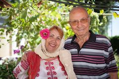 Romanian Elder Couple. The women dressed in Romanian traditional folk costume royalty free stock photography