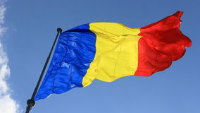 Romanian flag. Flowing at dusk Stock Photos