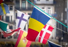 Romanian Flag Amidst Other Flags royalty free stock photos