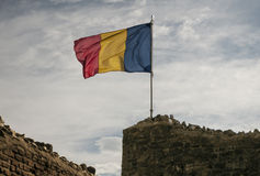 Romanian flag. And  the castle wall Royalty Free Stock Image