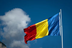 Romanian flag and clouds. The romanian flag waving next to threatening clouds Royalty Free Stock Photos