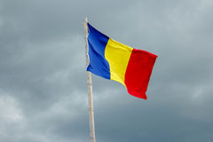 Romanian Flag on a dark sky background Stock Images