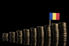 Romanian flag with lot of coins  on black Royalty Free Stock Images