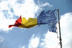 Romanian flag ripped of Stock Photo