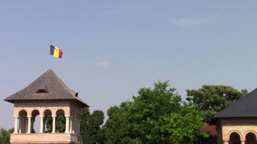 Romanian flag. On the roof of Mogosoaia Palace stock footage