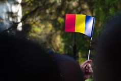 Romanian flagg. Romanian flag is waved in the crowd at Elisabeta Palace in Bucharest, Romania, during the Open Doors Event organised by the Romanian Royal Family Stock Images