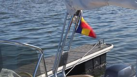 Romanian flag waving on boat Stock Images