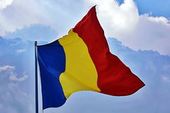 Romania flag. The romania flag waving on a cloudy sky stock images